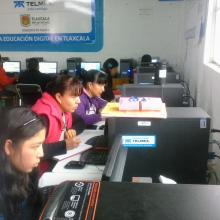 Young mothers studying on the library's computers.