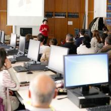 Journal editors working on computers during an EIFL-KOBSON workshop, while listening to an address by EIFL OA country coordinator in Serbia, Milica Ševkušić.