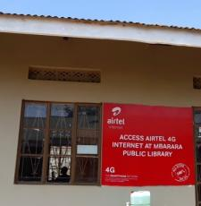 Front of Mbarara Public Library building, showing sign advertising Airtel internet access at the library.