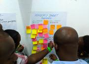 A group of Kenya National Library Service trainers post sticky notes to newsprint during training in Mombasa, Kenya.