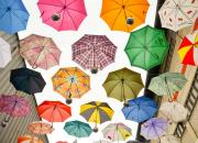Image from the course - multicoloured umbrellas in the sky, representing data protection.