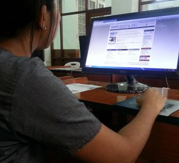 A student uses e-resources at the University of Yangon e-library in Myanmar, a project recently launched by EIFL.