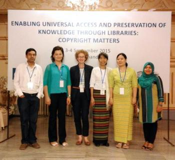 Copyright librarians from Nepal standing in front of the workshop banner.