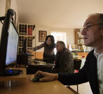 Librarians train farmers to use the internet in Bagrdan village library.