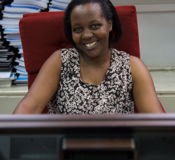 Grace Mugira, a librarian at the University of Nairobi library works at the computer uploading  to the Digital Repository Unit.