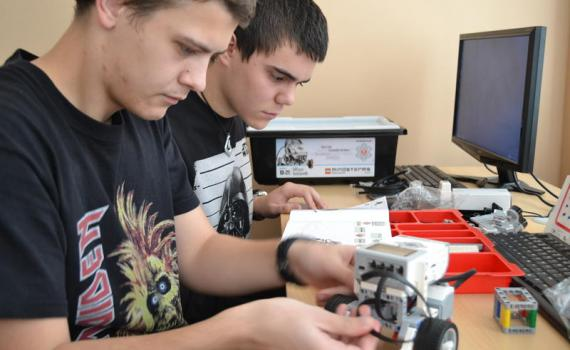 Students create programming to bring robots to life.