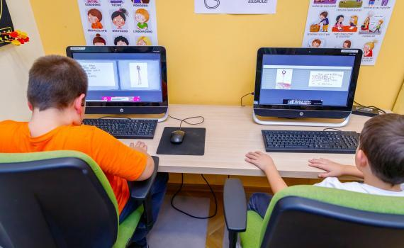 Two children learning digital and financial skills on computers In Prelog City Public Library.